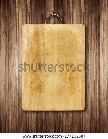 Old cutting boards for the kitchen Hanging on wooden wall - stock photo