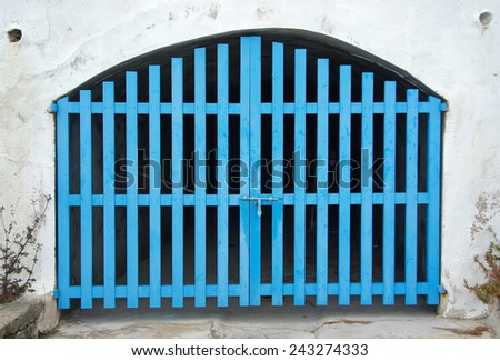 Old Cyan Wooden Door of a boat shelter in the Mediterranean Sea (Majorca) - stock photo