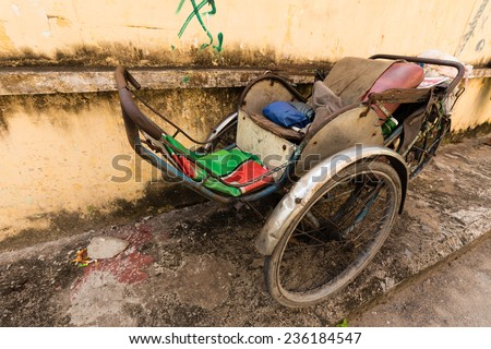 """Old Cyclo (called """"Xich Lo"""") in Ho Chi Minh city, Vietnam. Cyclo used to be a popular transportation in Vietnam, it is for tourism now. - stock photo"""