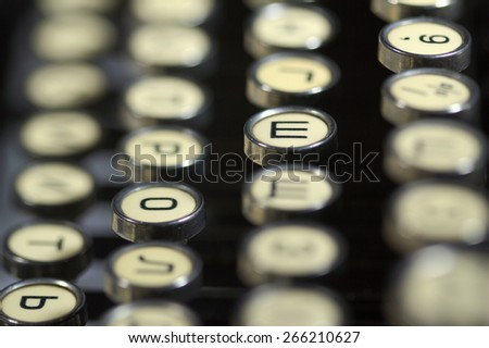 Old cyrillic typewriter - stock photo