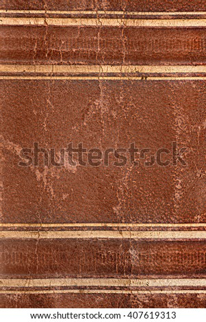 Old damaged brown leather book spine texture with spots and craquelures - stock photo