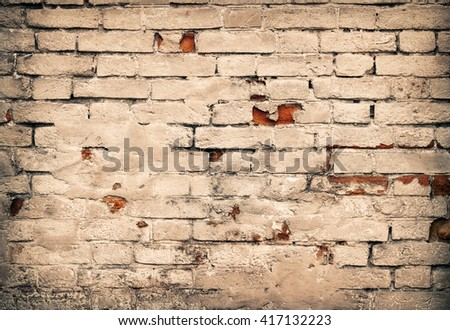 Old damaged red brick wall and white plaster as background - stock photo