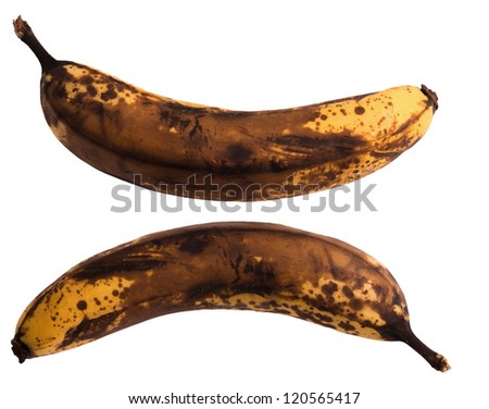 Old dark brown banana isolated on background - stock photo