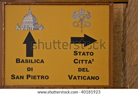 Old dark directional signs to landmarks in Vatican - stock photo