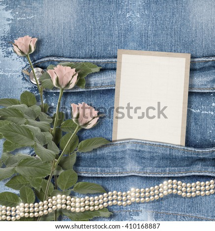 Old denim background with paper frame, pearls and pink roses - stock photo