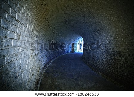 Old desolated tunnel with blue glowing effect, HDR processing. - stock photo