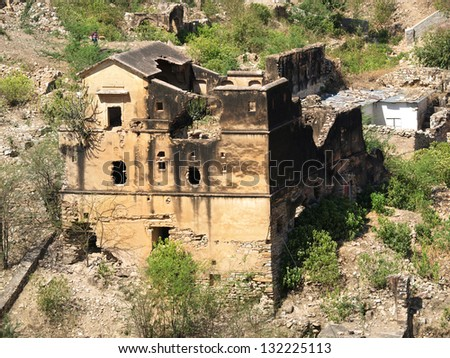 old destroyed and burned house - stock photo