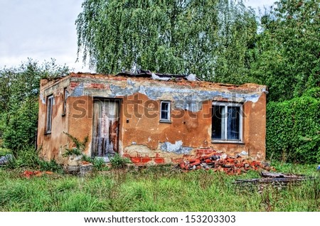 Old destroyed house with a removed roof in HDR - stock photo