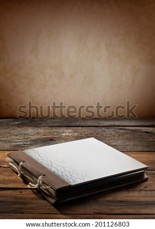 old diary book over wooden background - stock photo