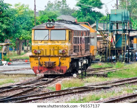 Old diesel electric locomotive in the yard of station. - stock photo