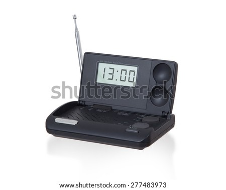 Old digital radio alarm clock isolated on white - Time is 13:00 - stock photo