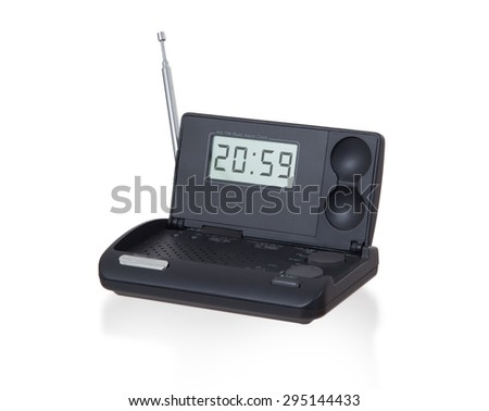 Old digital radio alarm clock isolated on white - Time is 20:59 - stock photo