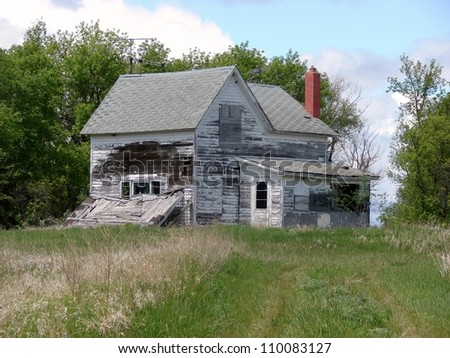old dilapidated farm buildings - stock photo