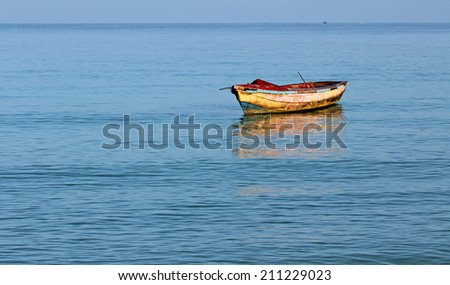 Old dirty angler's boat on Caribbean Sea , Jamaica - stock photo
