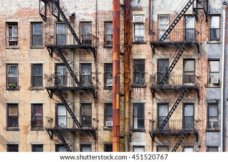 Old dirty apartment buildings facing an alley in New York City - stock photo
