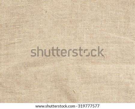 Old dirty brown horizontal creasy burlap texture - stock photo