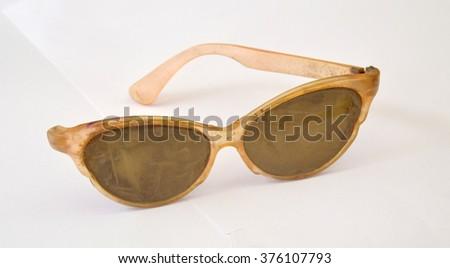 Old dirty  cat eye shaped sunglasses  - stock photo