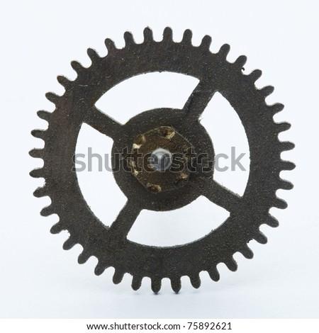 old dirty clock cogwheel - stock photo