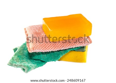 Old dirty dish washing sponges and soap on white background - stock photo