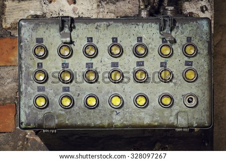 Old dirty electrical box with with push buttons in an old abandoned factory. - stock photo