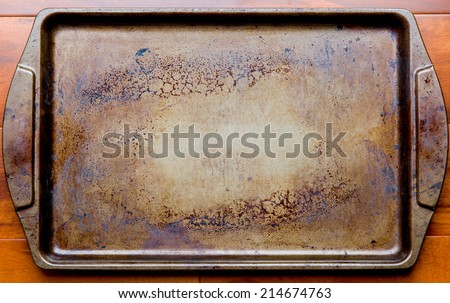 Old dirty oven baking tray - stock photo