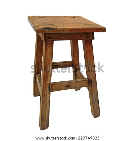 Old dirty wooden stool isolated on white background - stock photo