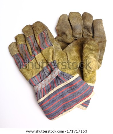 old dirty work gloves - stock photo
