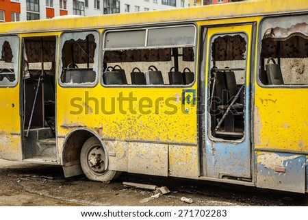 Old dirty yellow bus with broken windows  - stock photo