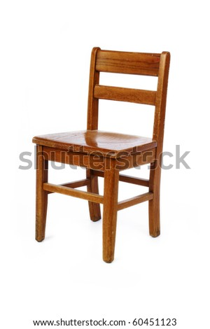 Old distressed wooden Childs chair on white - stock photo