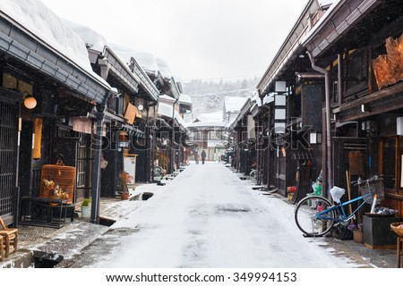 Old district wooden houses at historical Takayama town in Japan on winter day - stock photo