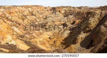 Old disused open-cast copper mine workings - stock photo