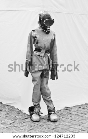 Old diving equipment  on a mannequin - stock photo