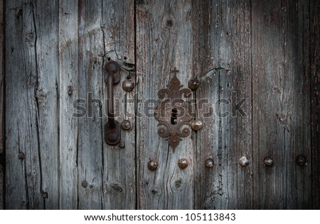 Old door and keyhole in romanesque chapel (Spain) - stock photo