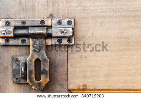 Old door bolt - stock photo