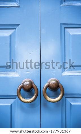 Old door detail, round handles - stock photo