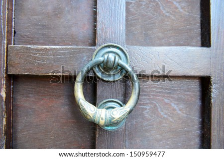 Old door handle - stock photo