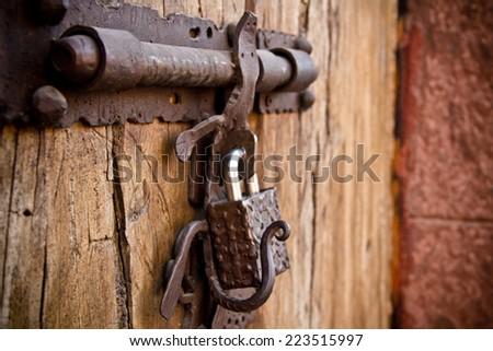 Old door handle and lock - stock photo