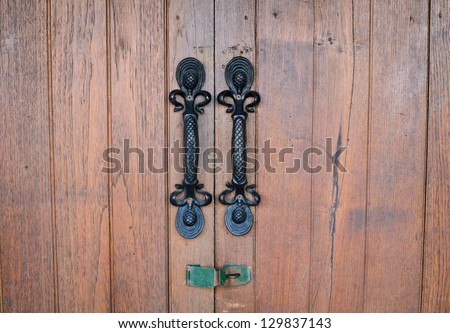 Old Door handle with wooden door - stock photo
