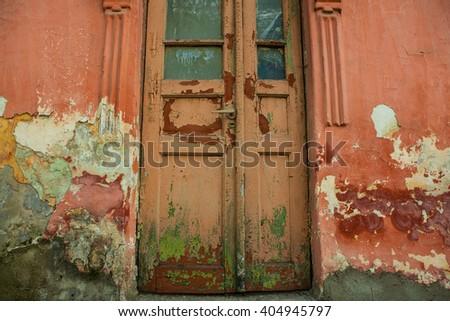 Old Door handles with an old double door painted. Antique door handles. Old vintage wooden door. - stock photo