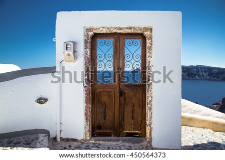 Old door in Oia village at suny day on Santorini island, Greece.