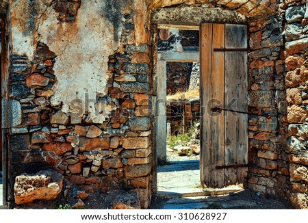 Old door. Inside the ruins of Spinalonga.  - stock photo