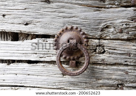 Old door knockers on an old door in Tuscany, italy - stock photo