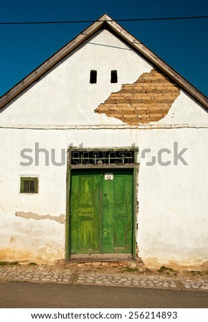 Old door of a wine cellar  - stock photo