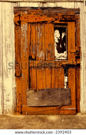 Old door of an old building in downtown Breaux Bridge, Louisiana. - stock photo