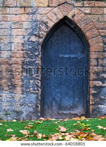 Old door on the side of Nottingham castle - stock photo