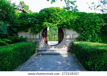 Old door with arch, yuyuan garden shanghai china. - stock photo