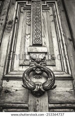 old doorknocker at a door - stock photo