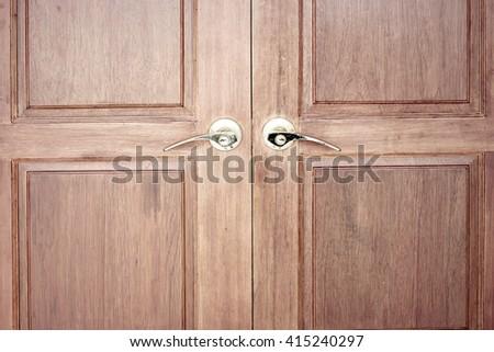 Old doors, Gold handles, locks, lattices and wood door. - stock photo