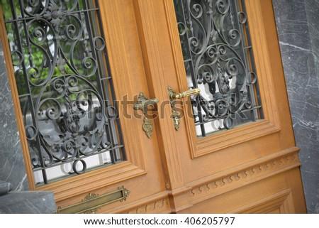 Old doors, handles, locks, lattices and windows - stock photo