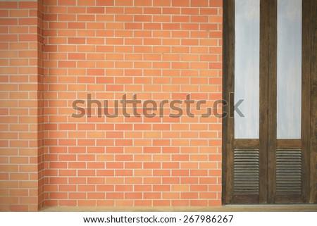 Old doors new orange brick wall. - stock photo